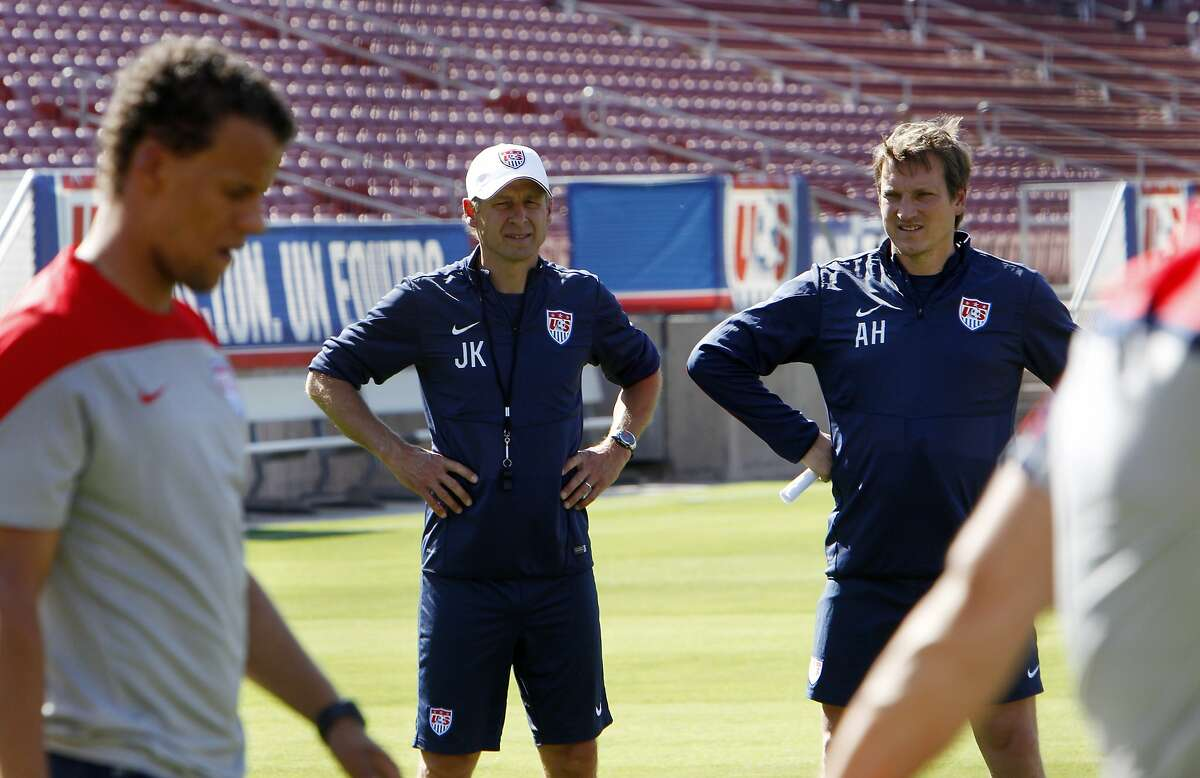 US Men's National Team coach Jurgen Klinsmann and assistant coach Andreas Herzog watch drills on Wednesday. Members of the US Men's National Soccer Team were introduced during an exhibition practice at Stanford University in Stanford, Calif., on Wednesday, May 14, 2014.