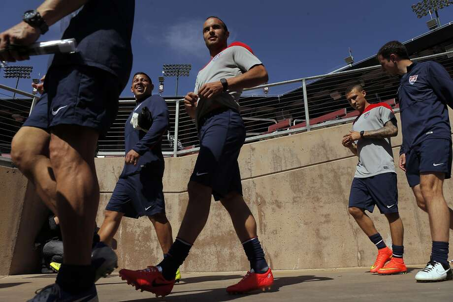 Landon Donovan (center) and others enter Stanford Stadium for the day's training session. Photo: Carlos Avila Gonzalez, The Chronicle