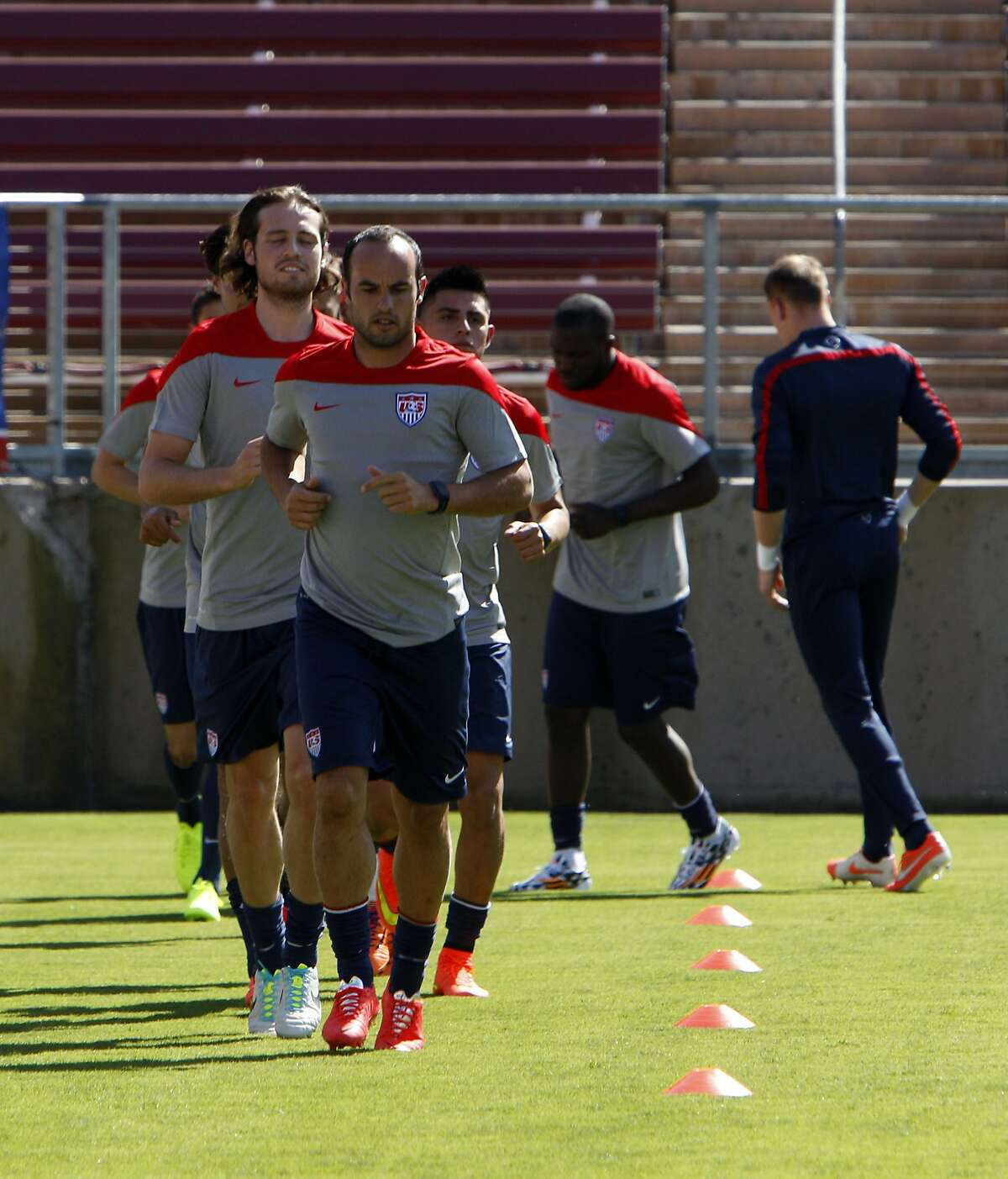 Landon Donovan leads members of the US Men's National Soccer team in drills at Stanford Stadium on Wednesday. The team was introduced during an exhibition practice at Stanford University in Stanford, Calif., on Wednesday, May 14, 2014.