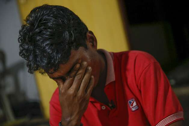 Mohamad Husein cries as he recounts his dangerous journey from Burma to North Malaysia. Photo: Vincent Thian, Associated Press
