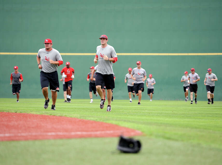 Lamar baseball players warm up for Tuesday's practice. The Lamar University Cardinals baseball team practiced Tuesday afternoon at Vincent-Beck Stadium. Photo taken Tuesday 5/13/14 Jake Daniels/@JakeD_in_SETX Photo: Jake Daniels / ©2014 The Beaumont Enterprise/Jake Daniels