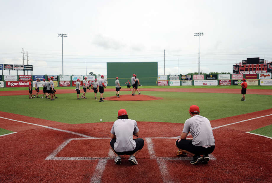 Lamar baseball players run through drills during Tuesday afternoon's practice. The Lamar University Cardinals baseball team practiced Tuesday afternoon at Vincent-Beck Stadium. Photo taken Tuesday 5/13/14 Jake Daniels/@JakeD_in_SETX Photo: Jake Daniels / ©2014 The Beaumont Enterprise/Jake Daniels