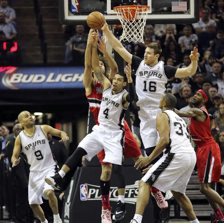 San Antonio Spurs' Danny Green and Aron Baynes grab for a rebound against Portland Trail Blazers' Robin Lopez during first half action of Game 5 in the Western Conference semifinals Wednesday May 14, 2014 at the AT&T Center. Photo: San Antonio Express-News