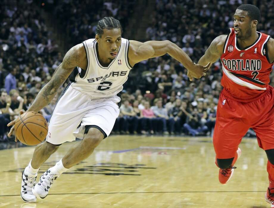 San Antonio Spurs' Kawhi Leonard drives around Portland Trail Blazers' Wesley Matthews during first half action of Game 5 in the Western Conference semifinals Wednesday May 14, 2014 at the AT&T Center. Photo: San Antonio Express-News