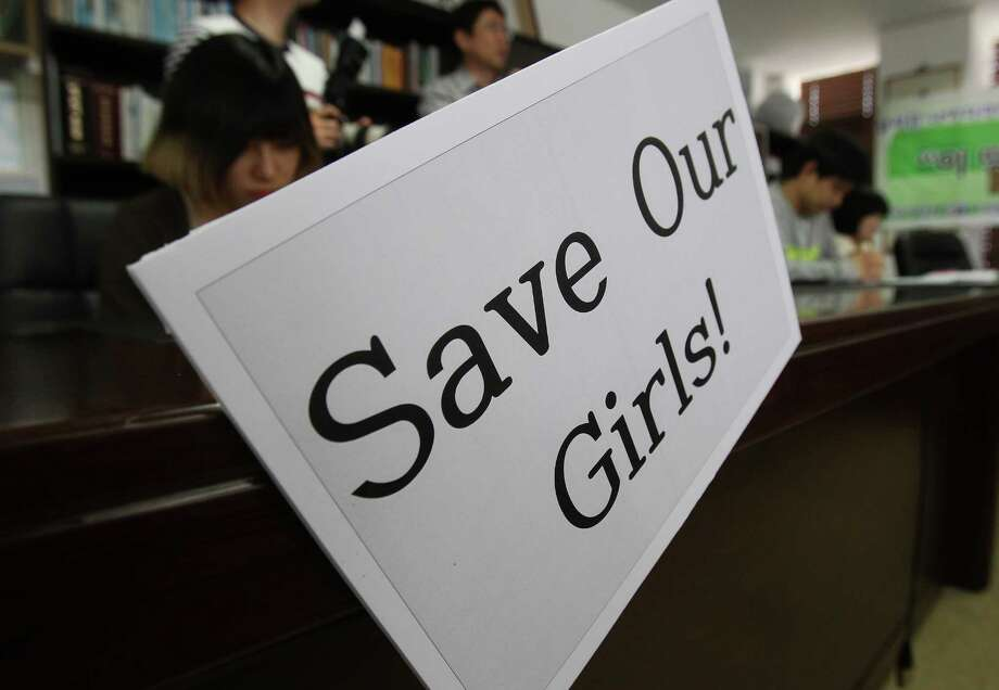 Christians pray during a service to support the release of kidnapped girls in Nigeria, at a church in Seoul, South Korea, Wednesday, May 14, 2014. Boko Haram, the militant group that kidnapped nearly 300 schoolgirls in Nigeria, said the girls will only be freed after the government releases jailed militants. (AP Photo/Ahn Young-joon) Photo: Ahn Young-joon, STF / AP