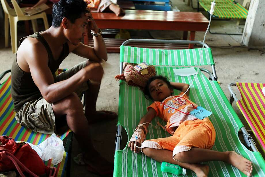 ALAMADA, MINDANAO, PHILIPPINES - MAY 14:  A father seats beside his daughter treated inside the hospital on May 14, 2014 in Alamada, Mindanao, Philippines.  At least nine people have died and more than 600 were hospitalized due to epidemic that hit far-flung villages. Cholera is an acute intestinal infection that causes severe vomiting and diarrhea, which can lead to serious dehydration and prove fatal if not properly treated. (Photo by Jeoffrey Maitem/Getty Images)  (Photo by Jeoffrey Maitem/Getty Images) *** BESTPIX *** Photo: Jeoffrey Maitem, Getty Images