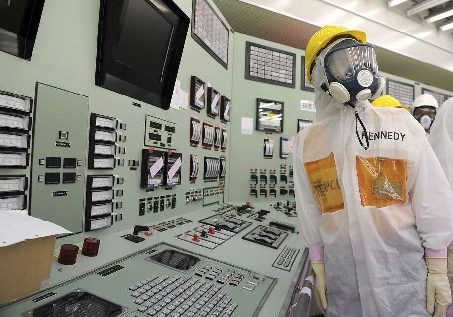 U.S. Ambassador to Japan Caroline Kennedy, wearing a helmet, protective suit and mask, inspects the central control room for the Unit One and Unit Two reactors of the tsunami-crippled Fukushima Dai-ichi nuclear power plant, operated by Japan's Tokyo Electric Power Co. (TEPCO), in Okuma, Fukushima Prefecture, northeastern Japan, Wednesday, May 14, 2014. Kennedy toured the plant for about three hours with her son, Jack Schlossberg. (AP Photo/Toru Yamanaka, Pool) Photo: Toru Yamanaka, Associated Press