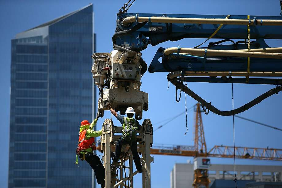 SAN FRANCISCO, CA - MAY 14:  Construction workers assemble a concrete pump on May 14, 2014 in San Francisco, California. The San Francisco Bay Area continues to experience record breaking temperatures with highs in the low 100s in the inland areas and 90s at the coast. The heat wave throughout the Bay Area will taper off on Thursday.  (Photo by Justin Sullivan/Getty Images) Photo: Justin Sullivan, Getty Images
