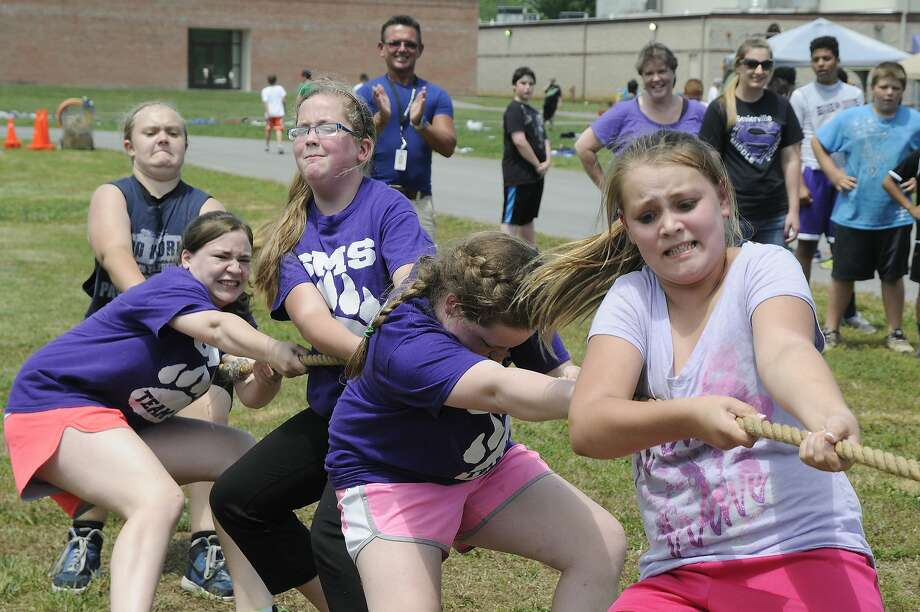 Sixth-grade girls compete in the tug of war during field day at Sevierville Middle School in Sevierville, Tenn., Wednesday, May 14, 2014. (AP Photo/The Mountain Press, Curt Habraken) Photo: Curt Habraken, Associated Press