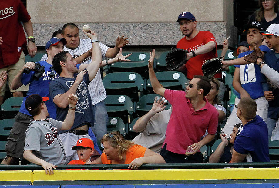 Fans in the Crawford Boxes had two chances to scramble for home run balls Wednesday, this time after a shot by the Rangers' Alex Rios in the second and again after George Springer's tying homer in the seventh. Photo: Karen Warren, Staff / © 2014 Houston Chronicle