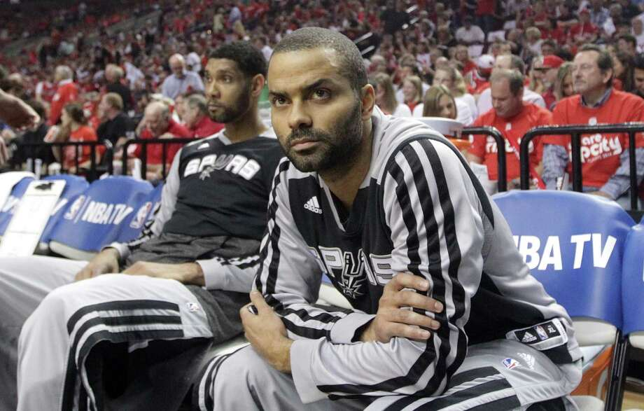 San Antonio Spurs' Tim Duncan, left, and Tony Parker, right, sit on the bench before the start of the Game 4 of a Western Conference semifinal NBA basketball playoff series against the Portland Trail Blazers Monday, May 12, 2014, in Portland, Ore. (AP Photo/Rick Bowmer) Photo: Rick Bowmer, STF / AP