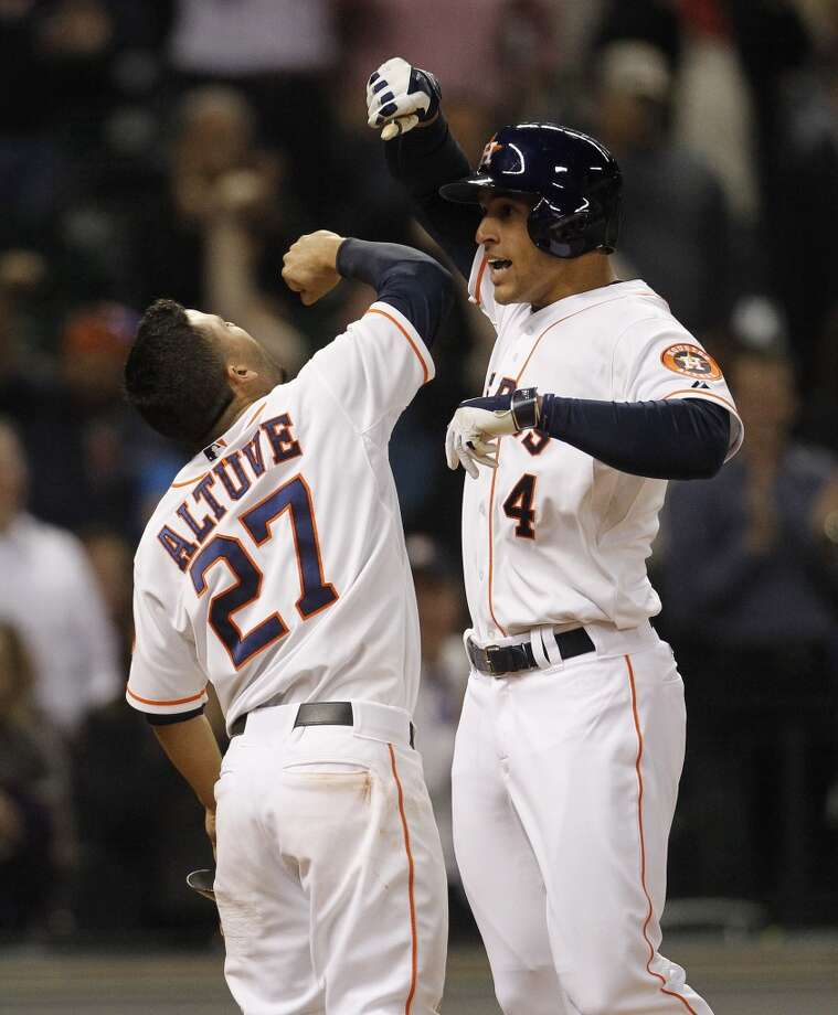 May 14: Astros 5, Rangers 4  George Springer, right, celebrates his game-tying two-run home run with Jose Altuve. Photo: Karen Warren, Houston Chronicle