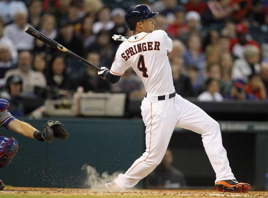 Astros right fielder George Springer fouls off a ball. Photo: Karen Warren, Houston Chronicle