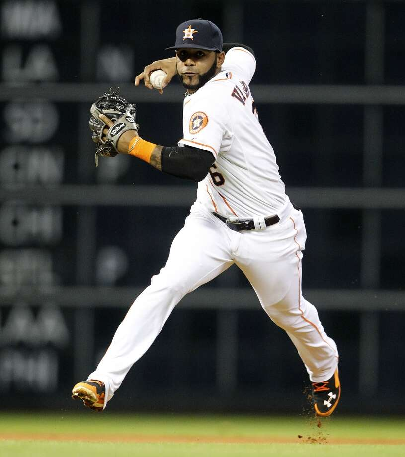 Astros shortstop Jonathan Villar winds up to make a throw to first base. Photo: Karen Warren, Houston Chronicle