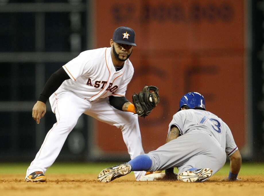 Astros shortstop Jonathan Villar, left, catches Rangers second baseman Rougned Odor attempting to steal second base. Photo: Karen Warren, Houston Chronicle