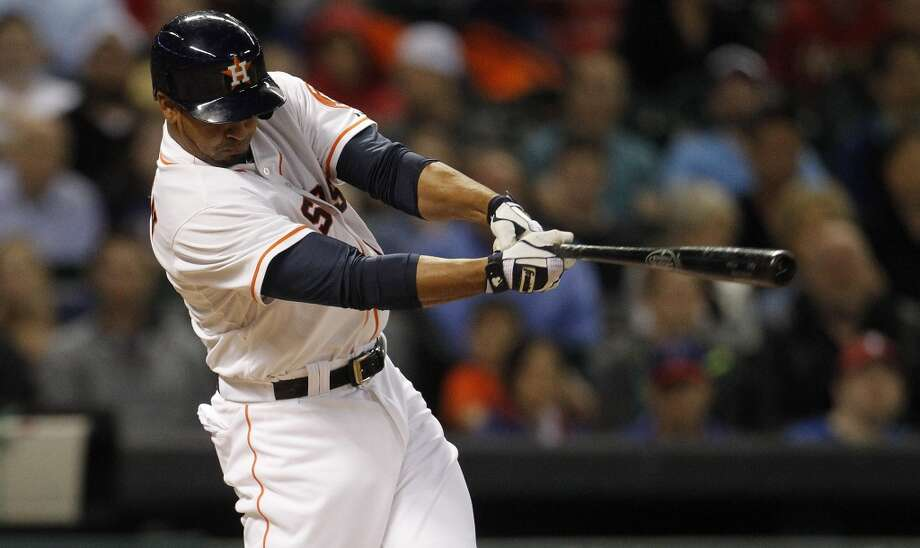 Astros first baseman Jesus Guzman hits an RBI single with bases loaded. Photo: Karen Warren, Houston Chronicle