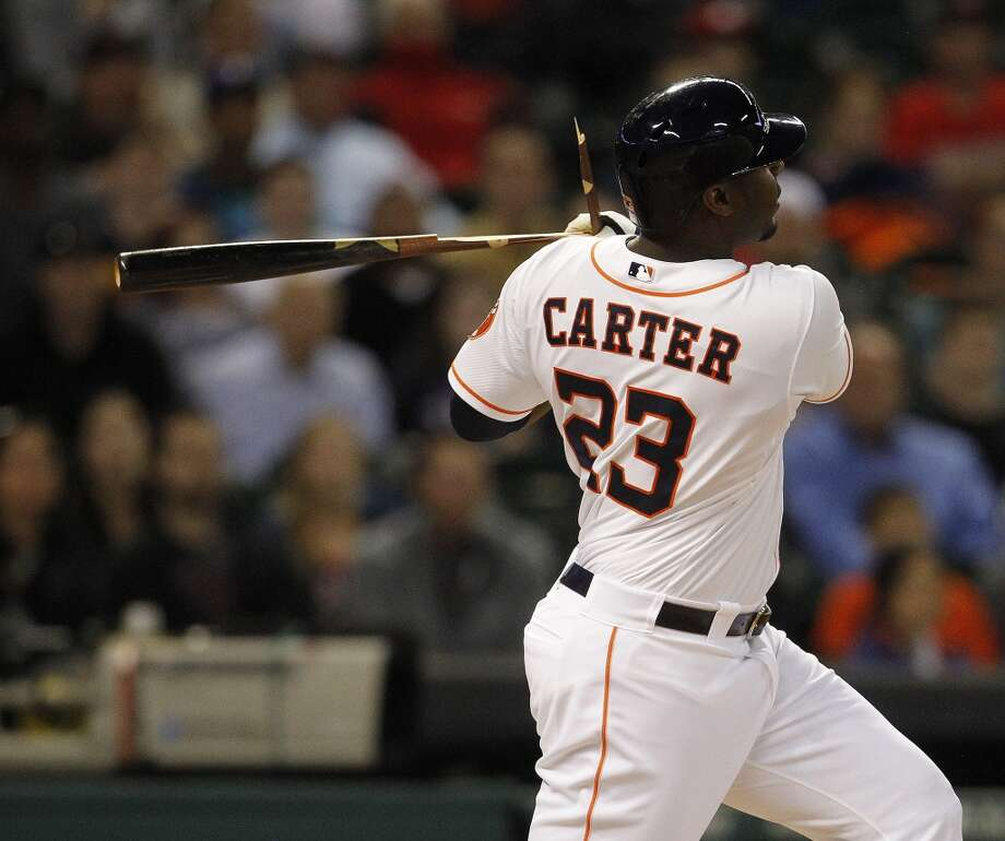 Designated hitter Chris Carter breaks his bat hitting an RBI single. Photo: Karen Warren, Houston Chronicle
