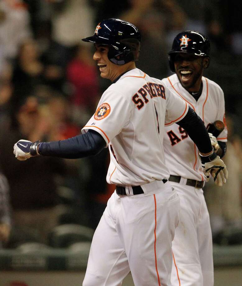 George Springer, left, and Dexter Fowler enjoy Springer's tying two-run homer in the seventh. Photo: Karen Warren, Staff / © 2014 Houston Chronicle