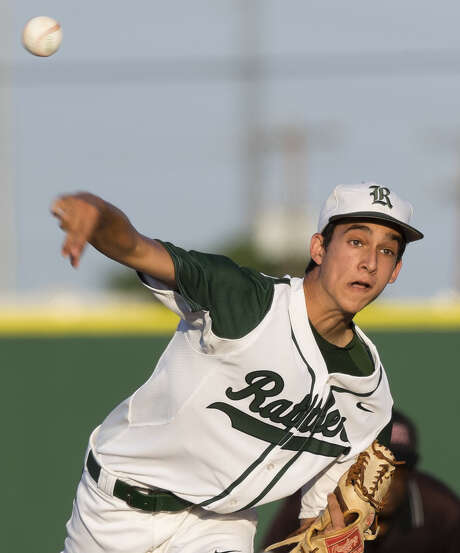Reagan ace Troy Montemayor is part of a senior-laden group that has meshed with younger players to put the Rattlers into the third round of the Class 5A playoffs, which start tonight. Photo: Darren Abate / For The Express-News