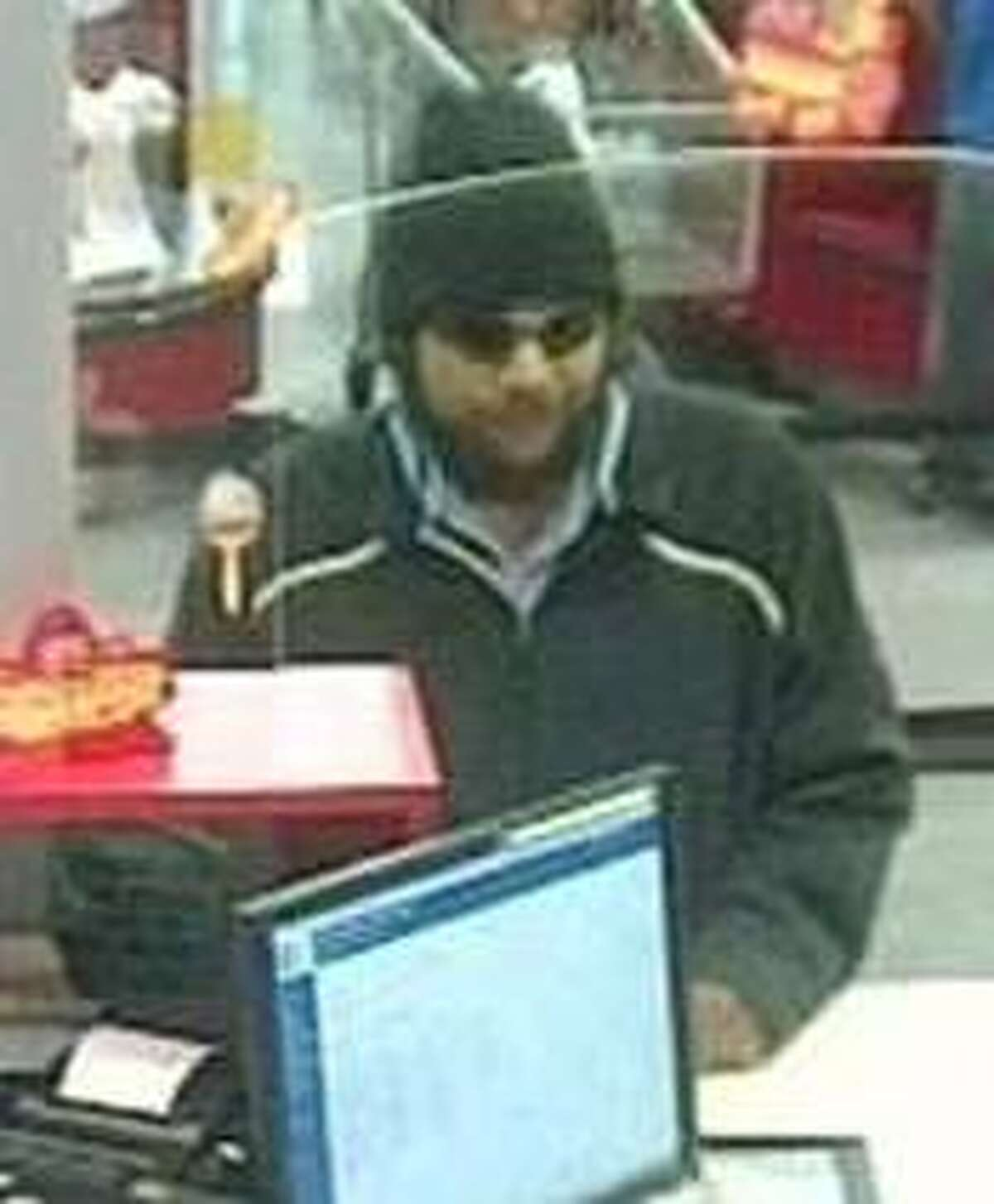 A surveillance image of the suspect in the robbery of a First Convenience Bank inside the Joe V's HEB.