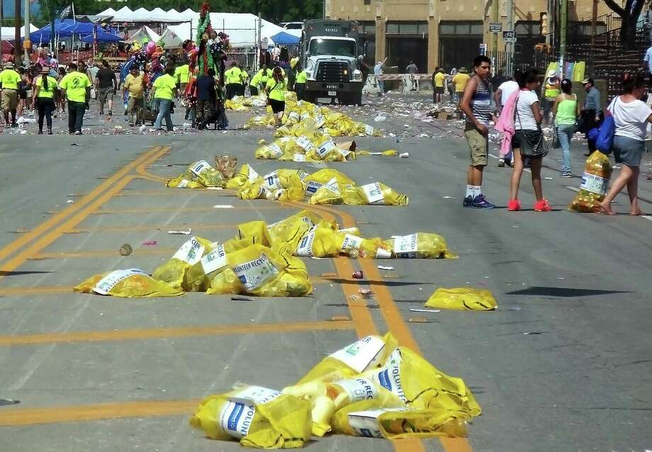 Five of the 20 tons of garbage generated at the Battle of Flowers Parade, or about 25 percent, was recycled, a city report states. That's down from about 33 percent last year. Photo: Scott Huddleston / San Antonio Express-News