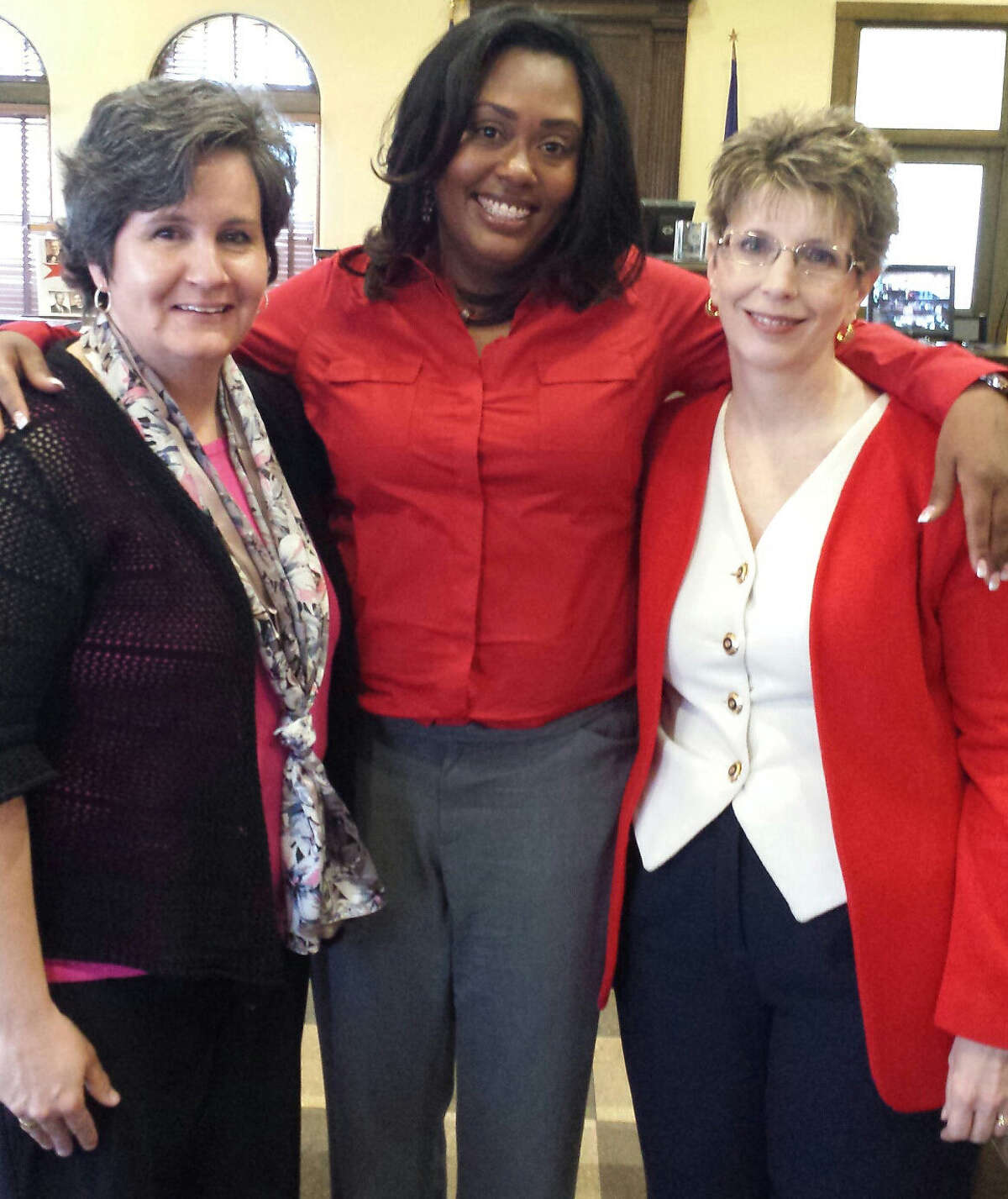 Allison Flood Lesh (center) with her attorneys Judith Wemmert (left) and Deanna Whitley, after they prevented the state of Texas from stopping the case.