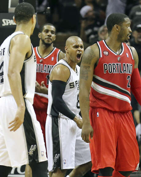 Patty Mills (center) exults in the second half — which Tony Parker sat out — after scoring two of his 18 points in the Spurs' series-clinching victory over Portland at the AT&T Center. Photo: Edward A. Ornelas / San Antonio Express-News / © 2014 San Antonio Express-News