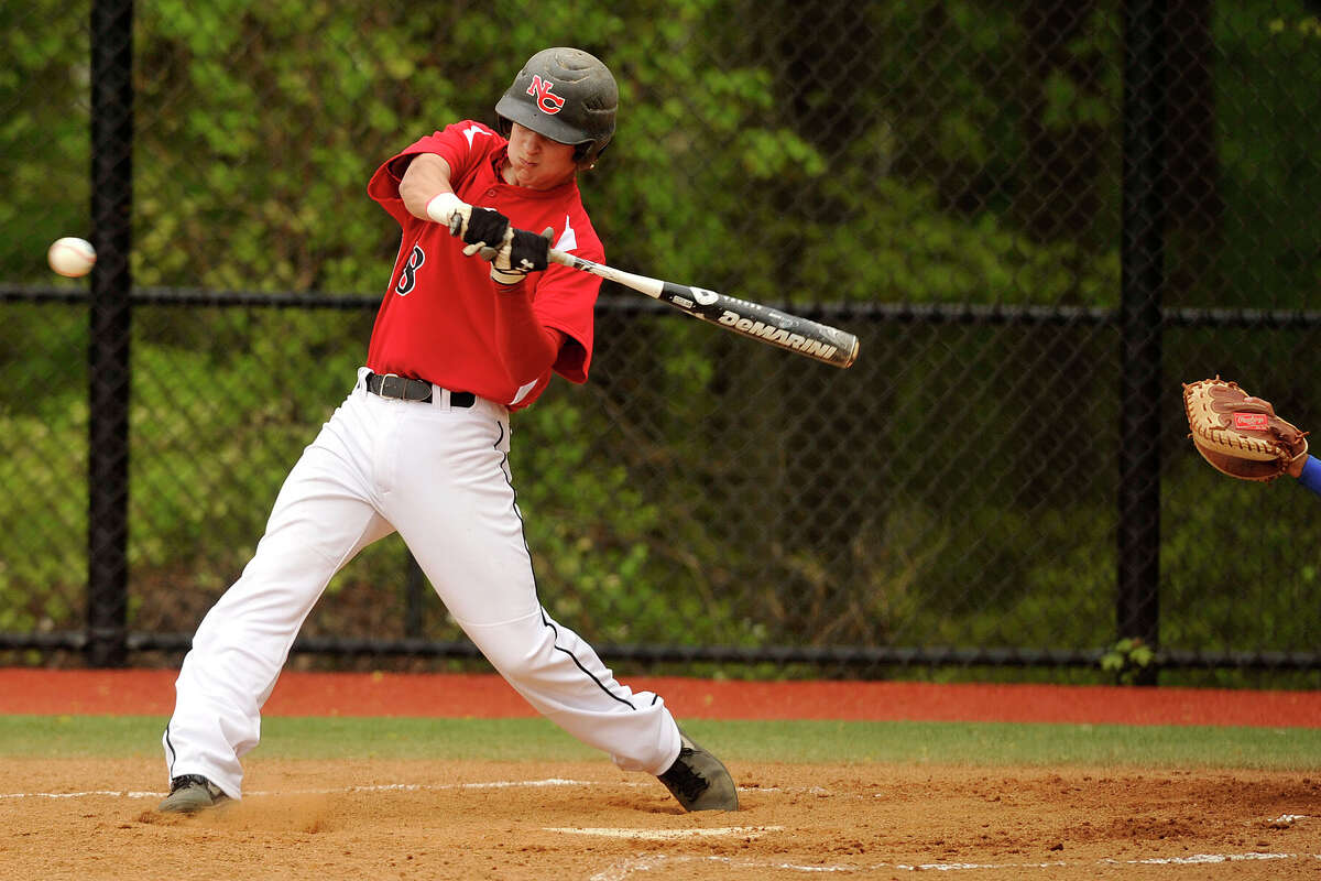 New Canaan's Brandon Abate swings at a pitch during the Rams' baseball game against Darien at Darien High School in Darien, Conn., on Wednesday, May 14, 2014. New Canaan won, 6-2.