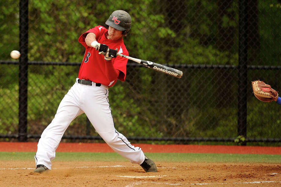 New Canaan's Brandon Abate swings at a pitch during the Rams' baseball game against Darien at Darien High School in Darien, Conn., on Wednesday, May 14, 2014. New Canaan won, 6-2. Photo: Jason Rearick / Stamford Advocate