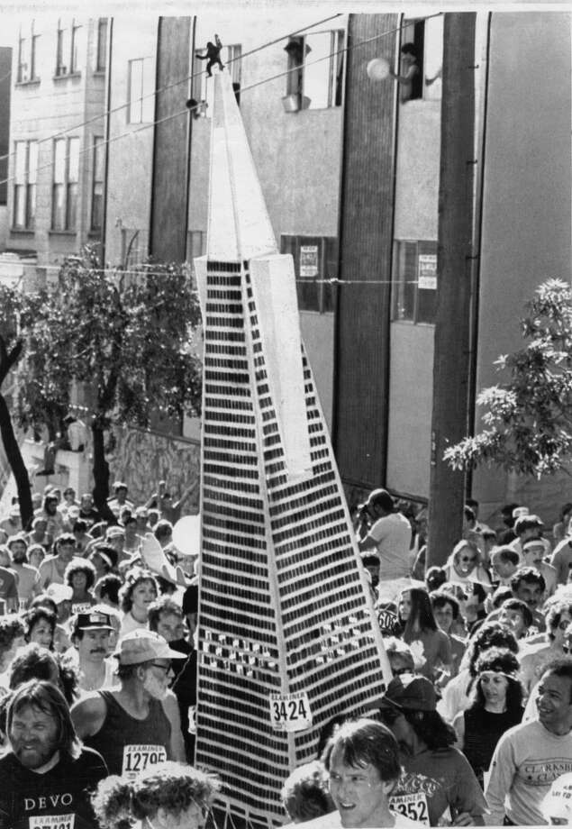 A runner costumed as the Transamerica Pyramid with a King Kong on top makes his way up the Hayes Street hill during the 1983 Bay to Breakers. There were some 54,000 official entrants in the 72nd running, and an estimated 20 to 30 thousand unofficial participants. Photo: Mike Hill