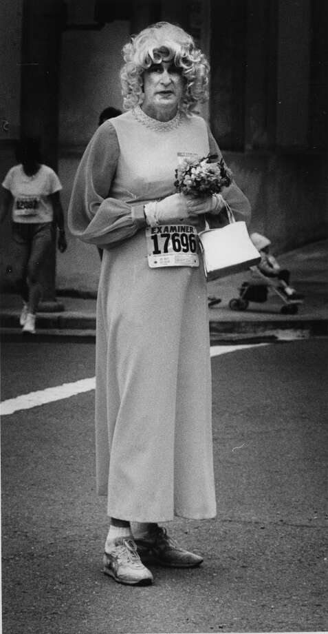 A man decked out in a long gown, blonde wig and running shoes waits for the start of Bay to Breakers, May 18, 1986. Photo: Frederic Larson