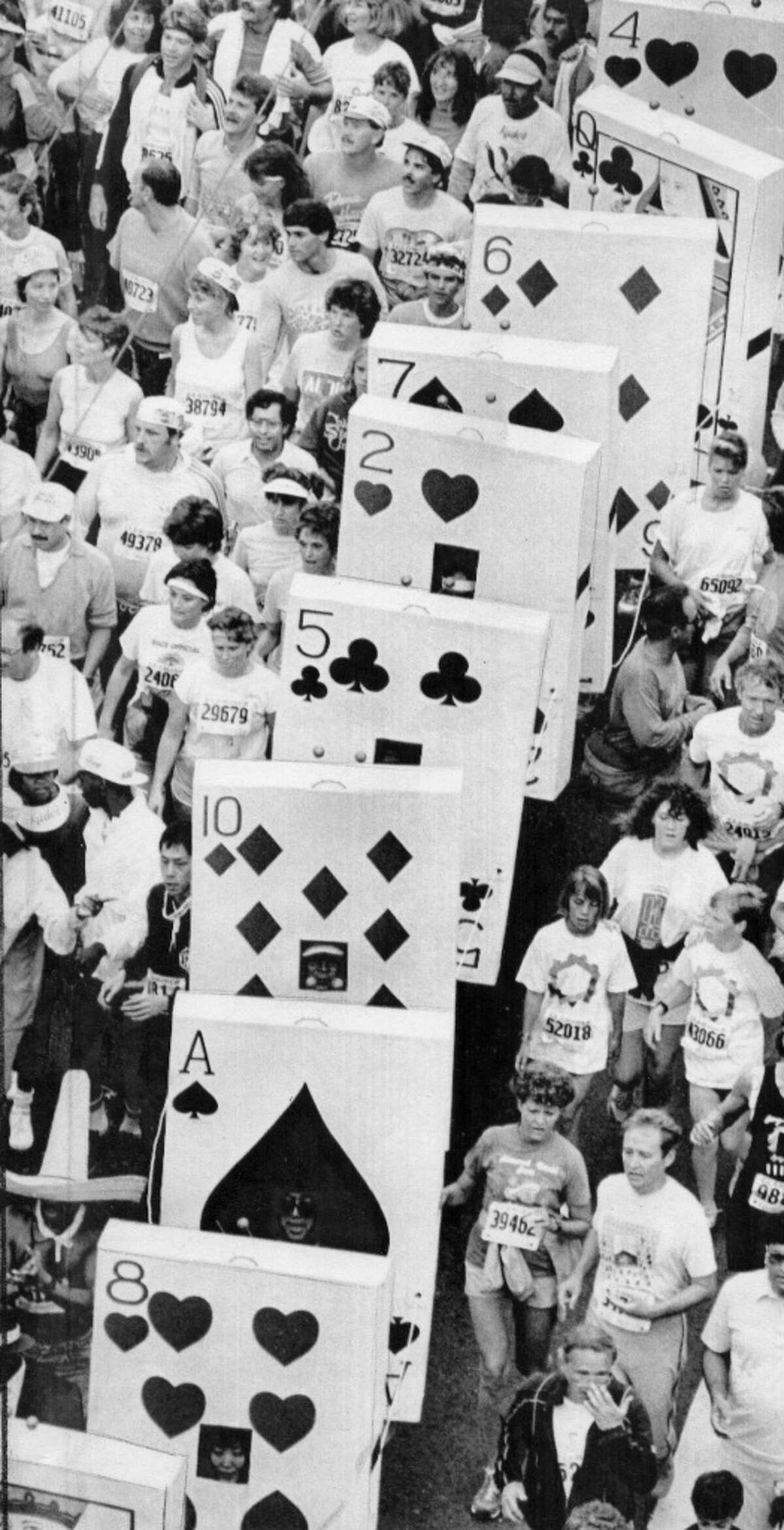 A pack of cards labors up the Hayes Street hill in the 1987 Bay to Breakers race.