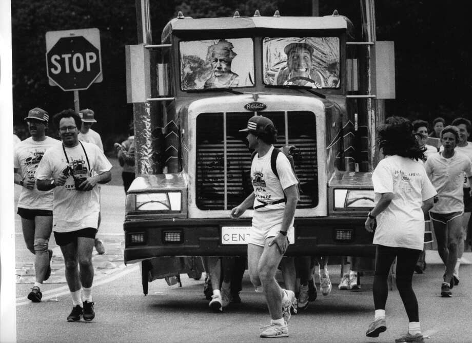An out of control truck, powered by swift feet, speeds past startled runners during the 1988 Bay to Breakers. Photo: Brant Ward