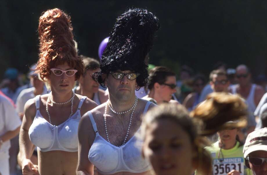 Two men with wigs and  gigantic bras make their way through Golden Gate Park during  89th annual Bay to Breakers (2000). Photo: BRANT WARD, The Chronicle