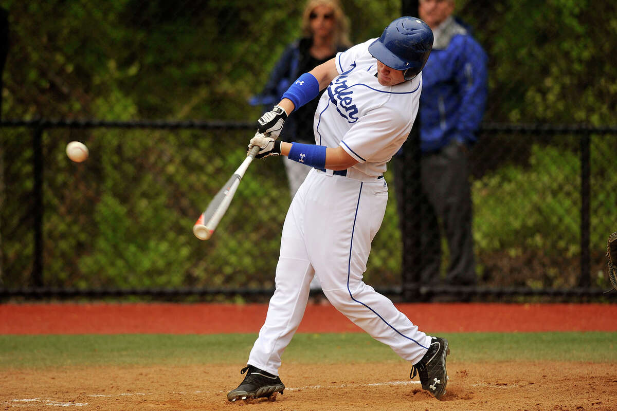 Darien's Peter Archey connects for a single during the Blue Wave's baseball game against New Canaan at Darien High School in Darien, Conn., on Wednesday, May 14, 2014. New Canaan won, 6-2.