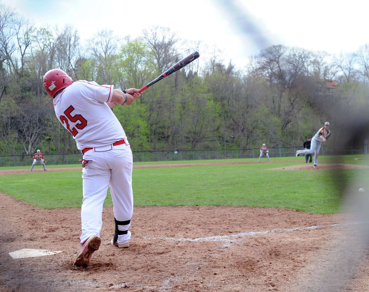 Justin Gaccione (#25) of Greenwich drives in a run on a hit in the bottom of the third inning during the high school baseball game between Greenwich High School and St. Joseph High School at Greenwich, Friday, May 2, 2014. Greenwich won 5-4 on a game winning double by Kyle Dunster in the bottom of the 7th inning.