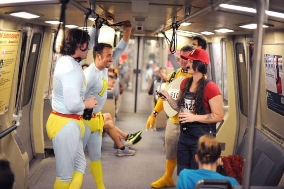 (L-R) Greg McPheter, Mason McDuffie, Jackson Coats and Jamie Predmore are seen taking BART from the East Bay on their way to the 102nd Bay to Breakers race on May 19th, 2013. Photo: Michael Short, Special To The Chronicle