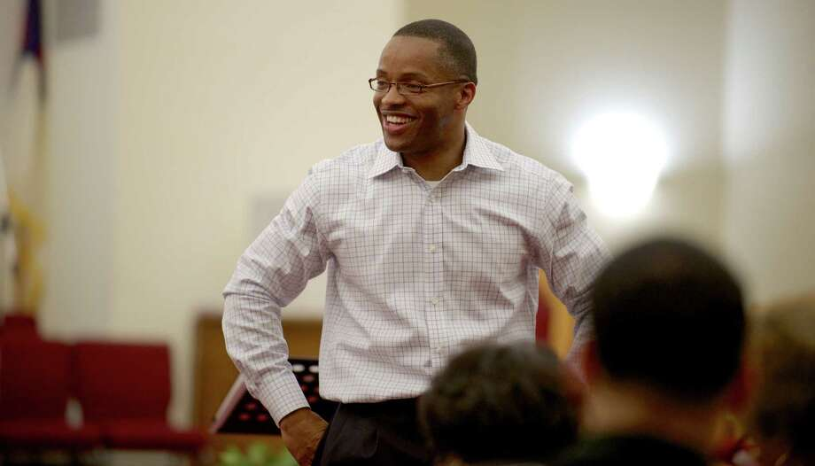 Reverend Leroy Gerome Parker, 38, of Bridgeport, teaches Bible study class in the sanctuary of New Hope Baptist Church, in Danbury, Conn, on Wednesday, night, May 14, 2014.  Parker is being installed as the new pastor of New Hope on Sunday, May 25th. He has been the interim pastor there since November of 2012 and served as the Assistant Pastor at Union Baptist Church, in Stamford, before that. Photo: H John Voorhees III / The News-Times Freelance