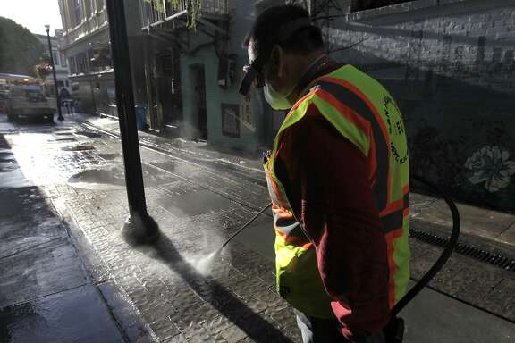 Steve Mahoney uses a power washer to clean Jack Kerouac Alley for the Department of Public Works in San Francisco, Calif. on Wednesday, May 14, 2014. Supervisor Scott Weiner is seeking to boost the department's budget and add additional cleaning crews to battle a growing problem of urine and feces covering streets and sidewalks throughout the city.