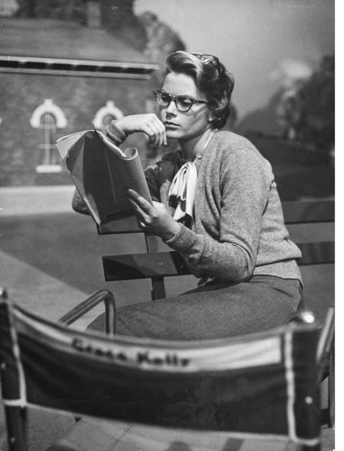 "1954:Grace Kelly studying the script for her role of Georgie in ""The Country Girl"" during break in filming. Photo: Ed Clark, Getty / 1954 Time Life"