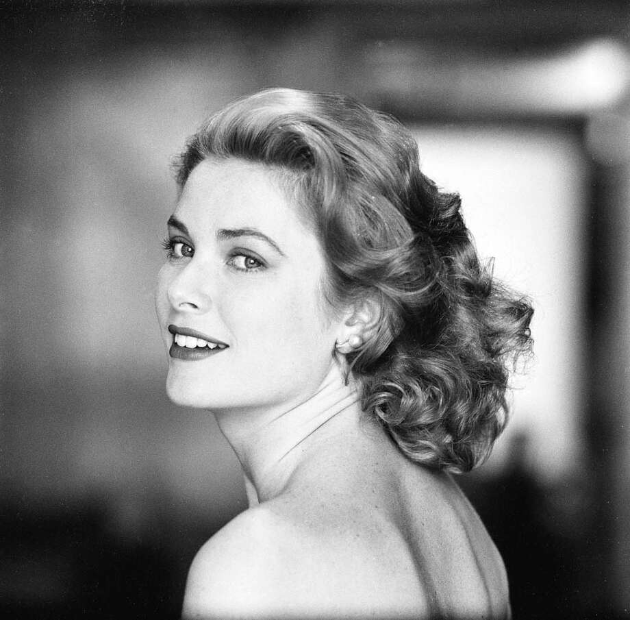 1954:Grace Kelly in a strapless gown as she looks over her shoulder. Photo: Sharland, Getty / Time & Life Pictures