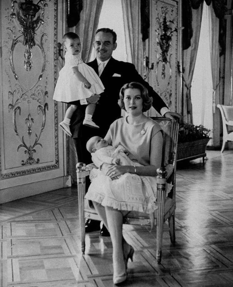 1958: Prince Rainier of Monaco holding his daughter Caroline, while his wife Grace holds their baby son Albert at their home. Photo: Time Life Pictures, Getty / Time Life Pictures