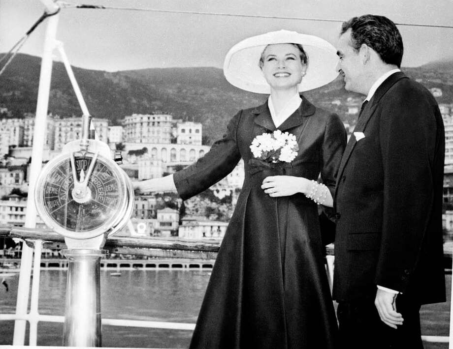 "1956: Prince Rainier III of Monaco and his fiancee US actress Grace Kelly are all smile aboard the princely yacht ""Deo Juvante II"" in Monte Carlo's harbor. Grace Kelly had arrived from USA for their wedding ceremony. Photo: AFP, Getty / 2011 AFP"