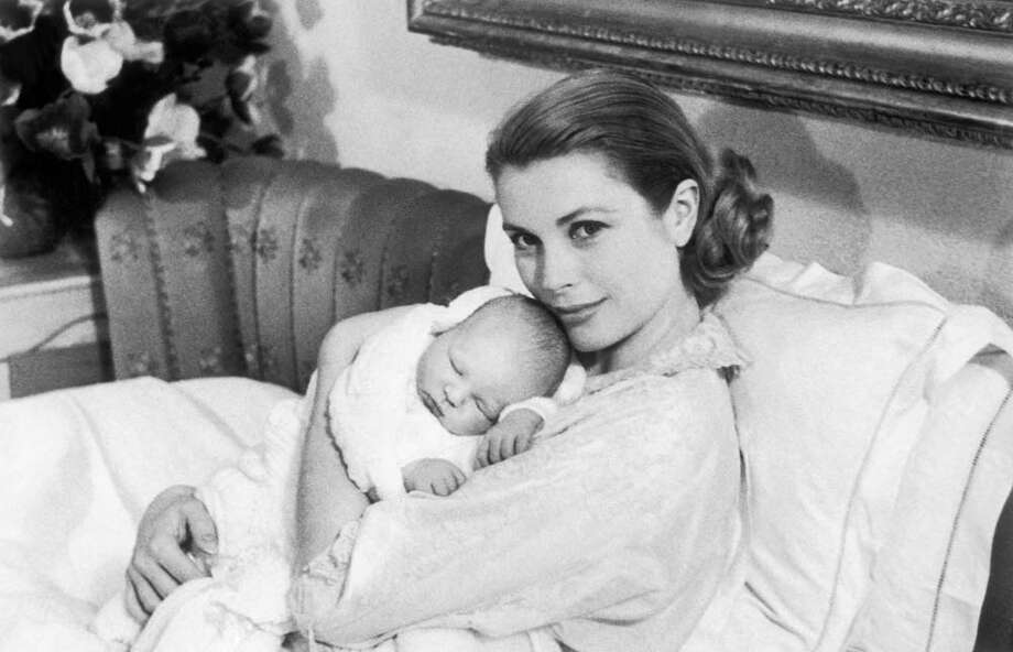 1958:  Princess Grace of Monaco tenderly holding her son, Prince Albert, born on March 14, 1958, in Monaco. Photo: Keystone-France, Getty / 1958 Keystone-France