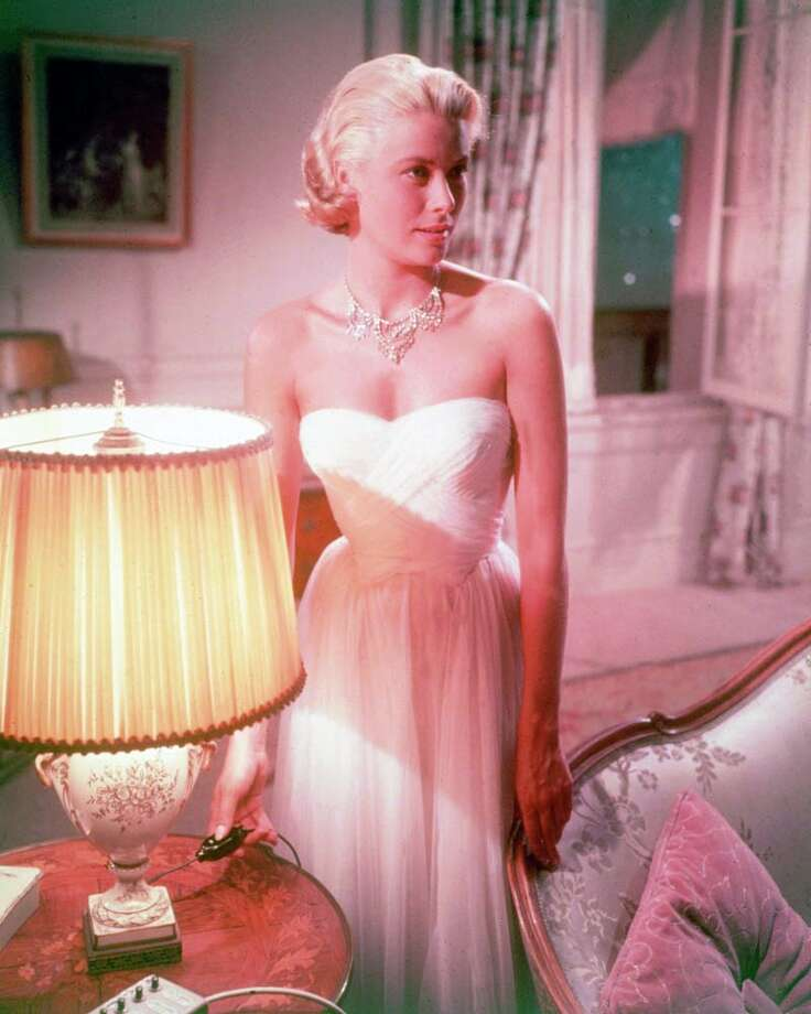 1955:Grace Kelly wearing a white strapless dress in a publicity still issued for the film, 'To Catch a Thief'. The romantic thriller, directed by Alfred Hitchcock, starred Kelly as 'Frances Stevens'. Photo: Silver Screen Collection, Getty / 2011 Silver Screen Collection