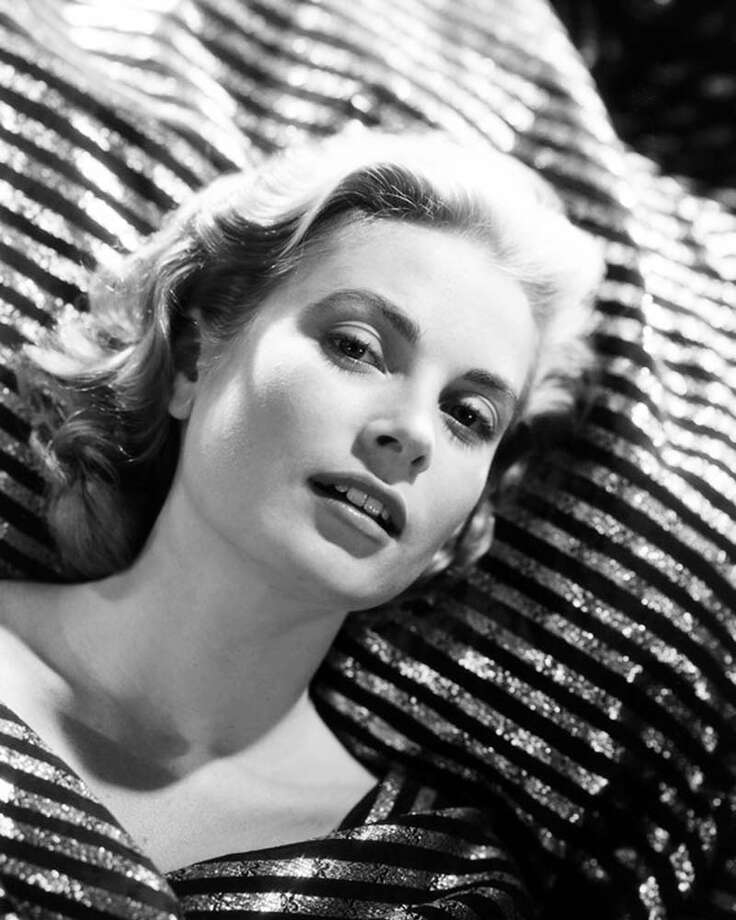 1955: Grace Kelly, reclining on striped fabric. Photo: Silver Screen Collection, Getty / 2013 Getty Images