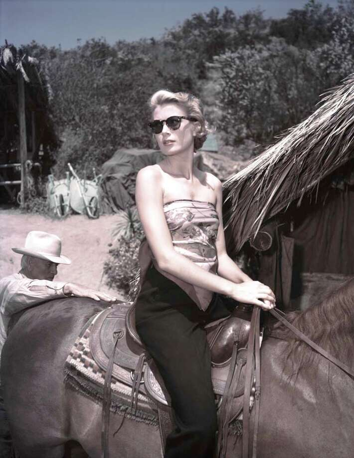 1953: Grace Kelly on horseback on the set of a film, probably 'Mogambo' Photo: Gene Lester, Getty / 2012 Gene Lester