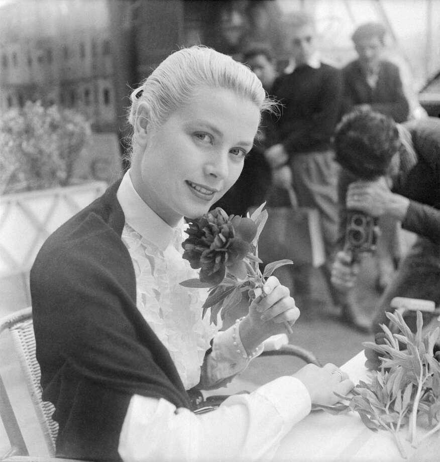 1955:Grace Kelly in Cannes for the international film festival. On this trip she met Prince Rainier of Monaco. Photo: Keystone-France, Getty / 2012 Gamma-Keystone