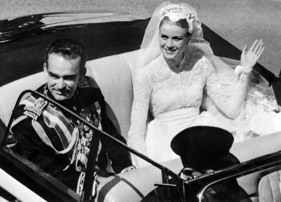 April 19, 1956: Prince Rainier III of Monaco and princess of Monaco Grace Kelly saluting the crowd as they leave Saint Nicholas' Cathedral after their wedding ceremony in Monaco.  Photo: -, Getty / AFP