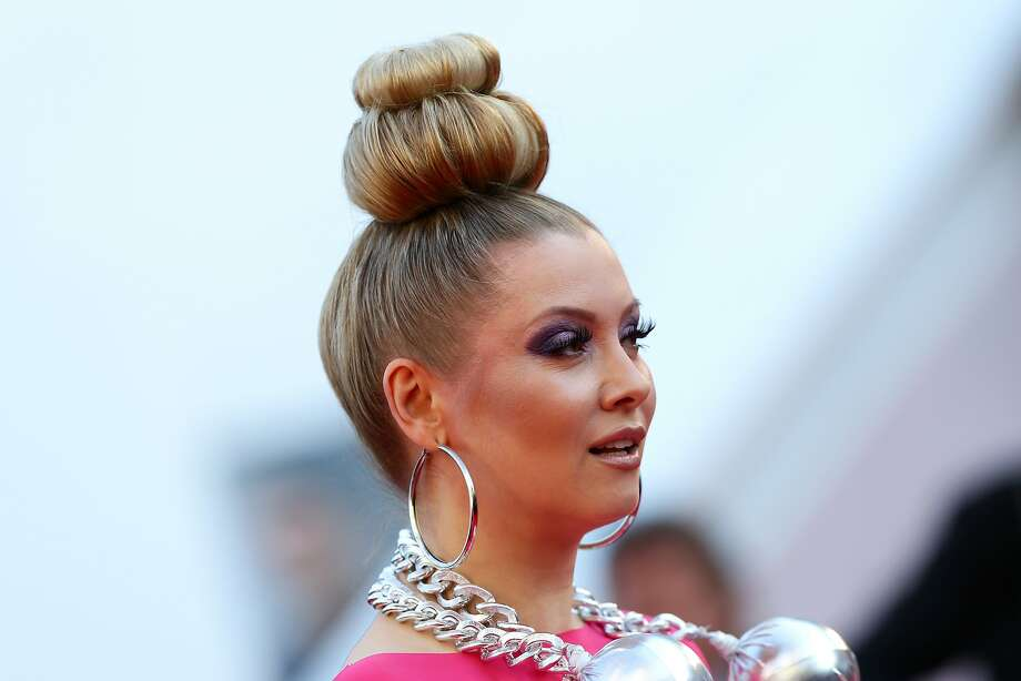Elena Lenina- Obviously, she's storing her cell phone in that hairdo. Photo: Vittorio Zunino Celotto, Getty Images